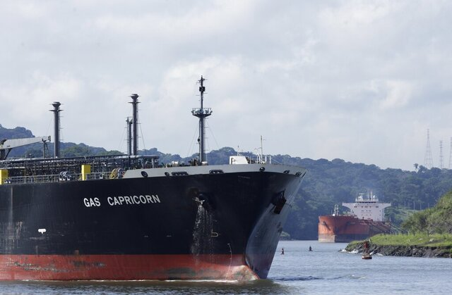 Cargo ships navigate through Panama Canal waters in Gamboa, Panama, Wednesday, June 17, 2020. The Panama Canal began to feel the first adverse effects of the coronavirus pandemic on its business after registering a drop in its ship transits while applying rigorous measures to prevent further contagion among its workers. (AP Photo/Arnulfo Franco)