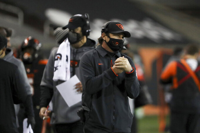 Oregon State head coach Jonathan Smith keeps an eye on the field during the second half of an NCAA college football game against Washington State in Corvallis, Ore., Saturday, Nov. 7, 2020. Washington State won 38-28. (AP Photo/Amanda Loman)