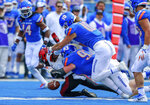 Boise State defensive tackle Chase Hatada (93) knocks the ball loose from San Diego State wide receiver BJ Busbee, left, in the first half of an NCAA college football game, Saturday, Oct. 6, 2018, in Boise, Idaho. Boise State recovered the fumble. (AP Photo/Steve Conner)
