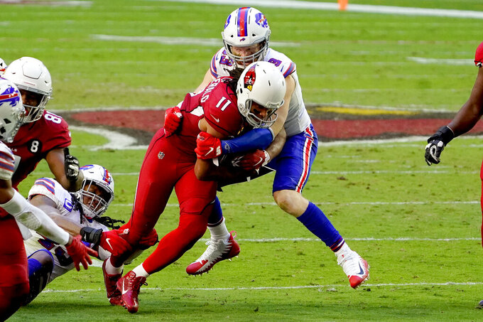 Arizona Cardinals wide receiver Larry Fitzgerald (11) is hit by Buffalo Bills safety Siran Neal (33) during the first half of an NFL football game, Sunday, Nov. 15, 2020, in Glendale, Ariz. (AP Photo/Rick Scuteri)