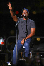 """Darius Rucker performs at Audacy's """"Stars and Strings"""" 9/11 benefit event at Pier 17 on Saturday, Sept. 11, 2021, in New York. (Photo by Andy Kropa/Invision/AP)"""