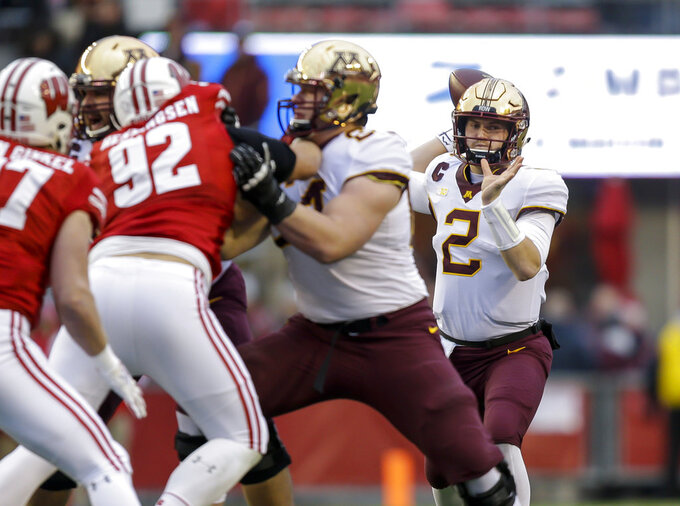 Minnesota quarterback Tanner Morgan (2) looks to pass against Wisconsin during the first half of an NCAA college football game Saturday, Nov. 24, 2018, in Madison, Wis. (AP Photo/Andy Manis)