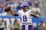 Minnesota Vikings quarterback Kirk Cousins (8) passes against the New York Giants during the first quarter of an NFL football game, Sunday, Oct. 6, 2019, in East Rutherford, N.J. (AP Photo/Adam Hunger)
