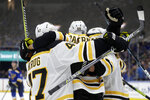 Boston Bruins right wing David Pastrnak (88), of the Czech Republic, celebrates after scoring against the St. Louis Blues during the third period of Game 6 of the NHL hockey Stanley Cup Final Sunday, June 9, 2019, in St. Louis. The Bruins won 5-1 to even the series 3-3. (AP Photo/Jeff Roberson)