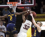 California's Juhwan Harris-Dyson (2) and Connor Vanover (23) double-team Arizona State's De'Quon Lake (32) during the first half of an NCAA college basketball game Sunday, Feb. 24, 2019, in Tempe, Ariz. (AP Photo/Darryl Webb)