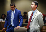 Lawyers Steve Farese Jr. and Blake Ballin stand in in Judge Lee Coffee's courtroom after asking to be withdrawn from representing Sherra Wright,  the ex-wife of slain former NBA player Lorenzen Wright, during an appearance Wednesday, July 11, 2018 in Memphis. Shelby County Criminal Court Judge Lee Coffee granted a motion from Farese Jr. and Ballin for their removal from the case of Wright. She is charged with murder in the July 2010 slaying of Lorenzen Wright.  (Mark Weber/The Commercial Appeal via AP)
