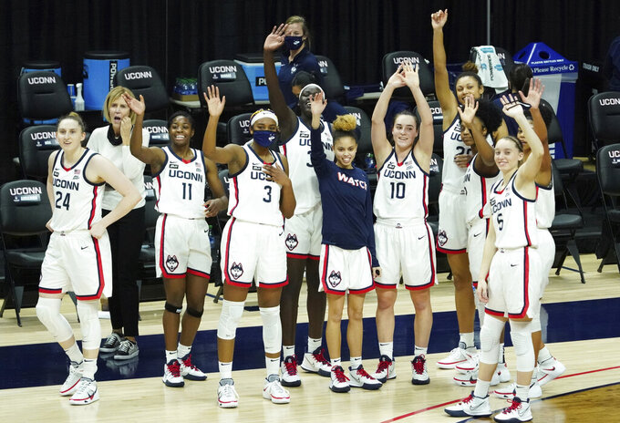Connecticut players wave to family and friends after an NCAA college basketball game against Providence at Harry A. Gampel Pavilion, Saturday, Jan. 9, 2021, in Storrs, Conn. (David Butler II/Pool Photo via AP)