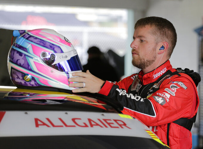 Justin Allgaier prepares for a NASCAR Xfinity Series auto race practice on Friday, Nov. 15, 2019, at Homestead-Miami Speedway in Homestead, Fla. Allgaier is one of four drivers racing for the series championship. (AP Photo/Terry Renna)