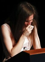 Amanda Knox gets emotional as she speaks at a Criminal Justice Festival at the University of Modena, Italy, Saturday, June 15, 2019. Knox, a former American exchange student who became the focus of a sensational murder case, arrived in Italy Thursday for the first time since an appeals court acquitted her in 2011 in the slaying of her British roommate. (AP Photo/Antonio Calanni)