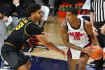 Missouri guard Mark Smith (13) defends against Mississippi guard Luis Rodriguez (15) during the first half of an NCAA college basketball game in Oxford, Miss., Wednesday, Feb. 10, 2021. (AP Photo/Rogelio V. Solis)
