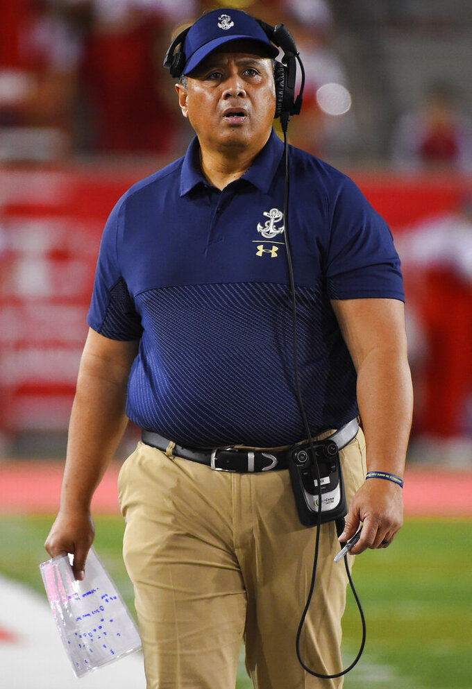 Navy head coach Ken Niumatalolo walks the sideline during the first half of an NCAA college football game against Houston, Saturday, Nov. 30, 2019, in Houston. (AP Photo/Eric Christian Smith)