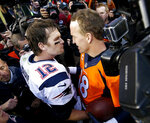 FILE - In this Sunday, Jan. 24, 2016 file photo, New England Patriots quarterback Tom Brady (12) and Denver Broncos quarterback Peyton Manning speak to one another following the NFL football AFC Championship game between the Denver Broncos and the New England Patriots in Denver. Tom Brady has been synonymous with the AFC championship for the last two decades. Thirteen times he played for the Lamar Hunt Trophy and nine times he won it. Peyton Manning he bested once but three other times he lost to his nemesis in the conference title game, twice in Denver.(AP Photo/David Zalubowski, File)