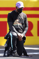 Mercedes driver Lewis Hamilton of Britain takes the knee on the grid before the British Formula One Grand Prix, at the Silverstone circuit, in Silverstone, England, Sunday, July 18, 2021. (Lars Baron/Pool photo via AP)