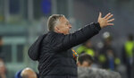 FILE  - In this Thursday, Nov. 28, 2019 file photo CFR's manager Dan Petrescu gives directions to his players during the Europa League soccer match between Lazio and CFR Cluj at Rome's Olympic stadium. In the Europe-wide race to finish this soccer season before the next one starts, Romania's league aims to beat a UEFA target for completion by resuming in two weeks' time. On Thursday, May 28, 2020, public authorities were agreeing protocols to keep players and officials safe for a June 13 restart in Liga 1. (AP Photo/Alessandra Tarantino, File)