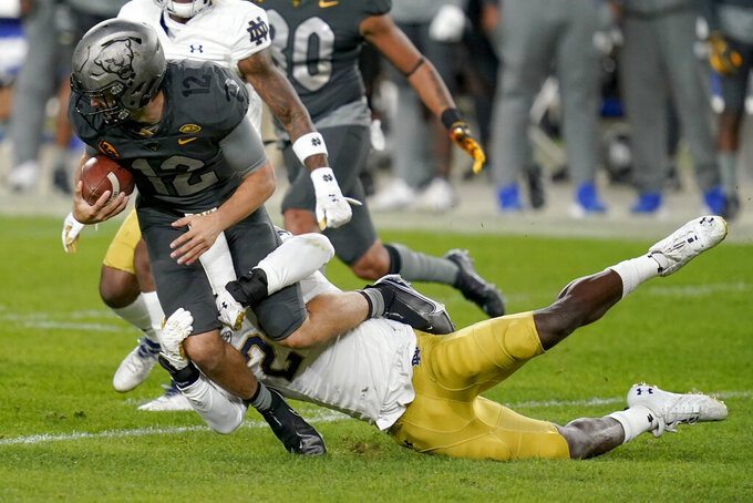 Notre Dame safety Shaun Crawford (20) tackles Pittsburgh quarterback Nick Patti (12) on a run during the second half of an NCAA college football game Saturday, Oct. 24, 2020, in Pittsburgh. (AP Photo/Keith Srakocic)