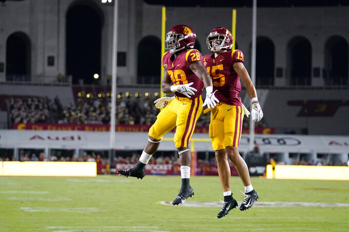 Southern California running back Keaontay Ingram (28) celebrates his rushing touchdown with wide receiver Drake London (15) during the first half of the team's NCAA college football game against Stanford on Saturday, Sept. 11, 2021, in Los Angeles. (AP Photo/Marcio Jose Sanchez)