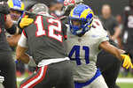 Los Angeles Rams inside linebacker Kenny Young, right, sacks Tampa Bay Buccaneers quarterback Tom Brady (12) during the second half of an NFL football game Sunday, Sept. 26, 2021, in Inglewood, Calif. (AP Photo/Kevork Djansezian)