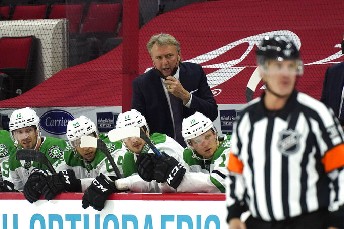 Dallas Stars coach Rick Bowness reacts during the second period of the team's NHL hockey game against the Carolina Hurricanes in Raleigh, N.C., Sunday, April 4, 2021. (AP Photo/Gerry Broome)