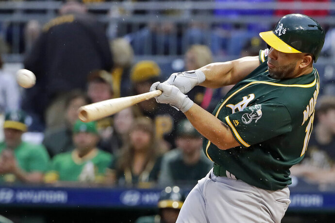 Oakland Athletics' Kendrys Morales drives in a run with a triple off Pittsburgh Pirates starting pitcher Trevor Williams during the first inning of a baseball game in Pittsburgh, Saturday, May 4, 2019. (AP Photo/Gene J. Puskar)