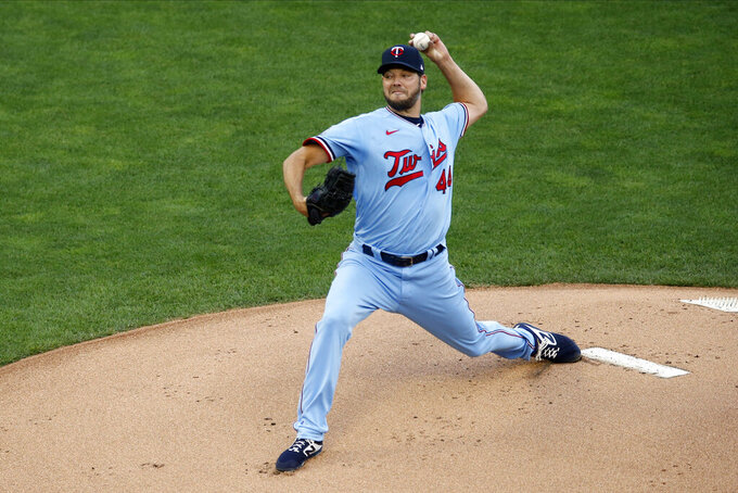 Minnesota Twins pitcher Rich Hill throws against the St. Louis Cardinals in the first inning of a baseball game Wednesday, July 29, 2020, in Minneapolis. (AP Photo/Jim Mone)