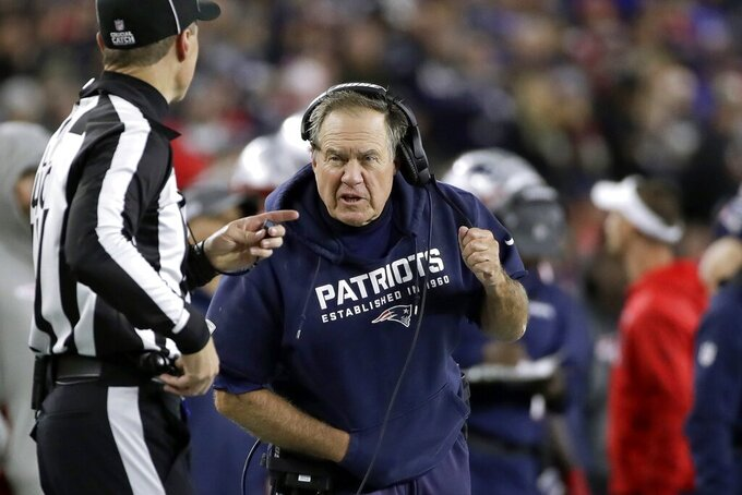 New England Patriots head coach Bill Belichick, right, appeals to line judge Brian Bollinger in the first half of an NFL football game, Thursday, Oct. 10, 2019, in Foxborough, Mass. (AP Photo/Elise Amendola)