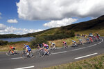 The pack rides during the stage 13 of the Tour de France cycling race over 191 kilometers from Chatel-Guyon to Puy Mary, Friday, Sept. 11, 2020. (AP Photo/Christophe Ena)