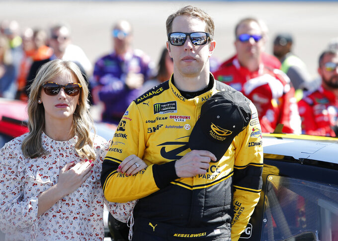 Driver Brad Keselowski and wife Paige prior to the start of the NASCAR Cup Series auto race at ISM Raceway, Sunday, March 10, 2019, in Avondale, Ariz. (AP Photo/Ralph Freso)