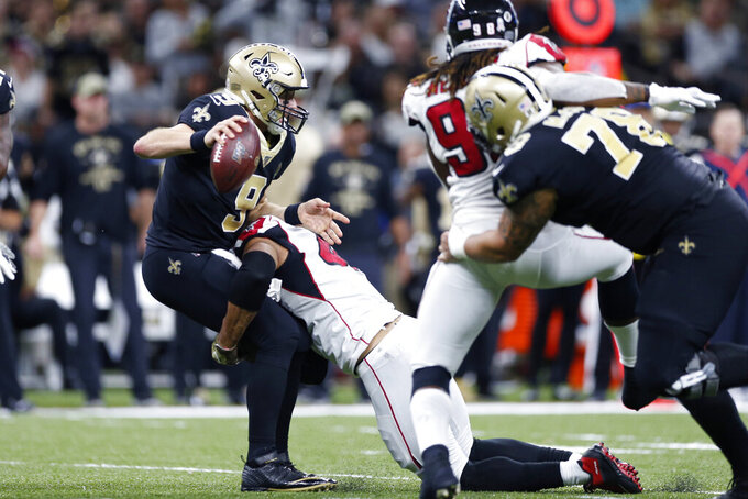New Orleans Saints quarterback Drew Brees (9) is sacked by Atlanta Falcons defensive end Vic Beasley in the second half of an NFL football game in New Orleans, Sunday, Nov. 10, 2019. (AP Photo/Rusty Costanza)