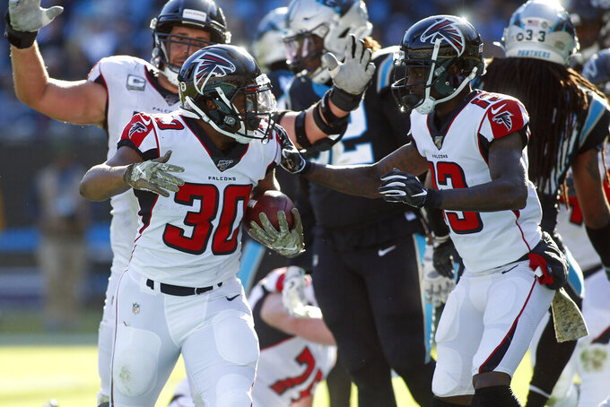Atlanta Falcons running back Qadree Ollison (30) and wide receiver Christian Blake (13) celebrate Ollison's touchdown against the Carolina Panthers during the first half of an NFL football game in Charlotte, N.C., Sunday, Nov. 17, 2019. (AP Photo/Brian Blanco)