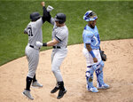 New York Yankees' Luke Voit, center, celebrates with Aaron Hicks (31) after hitting a two-run home run during the seventh inning of the first baseball game in a doubleheader against the Kansas City Royals, Saturday, May 25, 2019, in Kansas City, Mo. (AP Photo/Charlie Riedel)