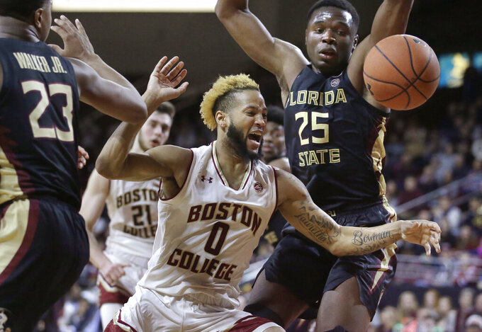 Boston College's Ky Bowman (0) and Florida State's Mfiondu Kabengele (25) chase the ball as Boston College forward Nik Popovic (21) looks on in the second half of an NCAA college basketball game, Sunday, Jan. 20, 2019, in Boston. (AP Photo/Steven Senne)