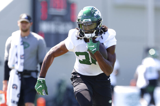 New York Jets running back Josh Adams (36) runs a drill during practice at the team's NFL football training facility, Saturday, July. 31, 2021, in Florham Park, N.J. (AP Photo/Rich Schultz)