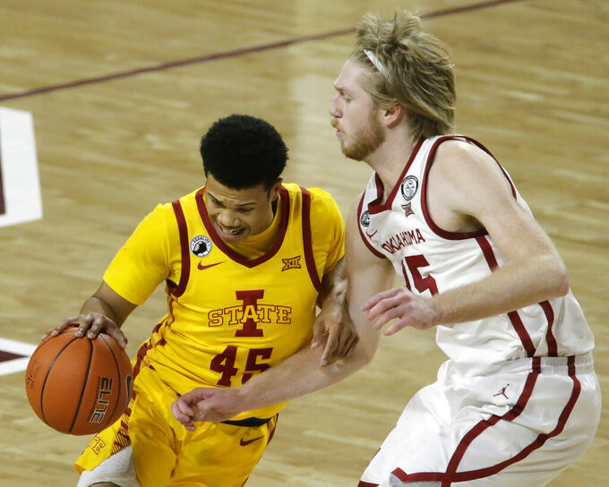 Iowa State's Rasir Bolton (45) drives against Oklahoma's Brady Manek (35) during the first half of an NCAA college basketball game in Norman, Okla., Saturday, Feb. 6, 2021. (AP Photo/Garett Fisbeck)