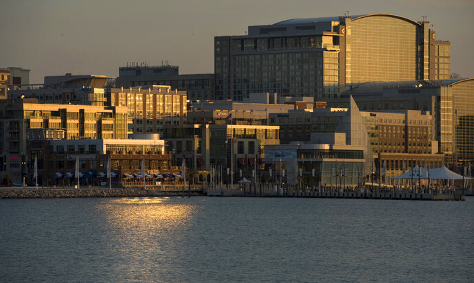 FILE- This Feb. 17, 2012 file photo shows the National Harbor, a multi-use waterfront development along the Potomac River in Prince George's County, Md. and entertainment complex near Washington, D.C. A court-appointed psychologist was appointed for Rondell Henry after he was arrested before carrying out an Islamic-State attack on the National Harbor complex. The psychologist found that Henry is