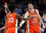 Illinois forward Giorgi Bezhanishvili, right, smiles as he celebrates with guard Andres Feliz after scoring a basket against Northwestern during the first half of an NCAA college basketball game in the first round of the Big Ten Conference tournament in Chicago, Wednesday, March 13, 2019. (AP Photo/Nam Y. Huh)