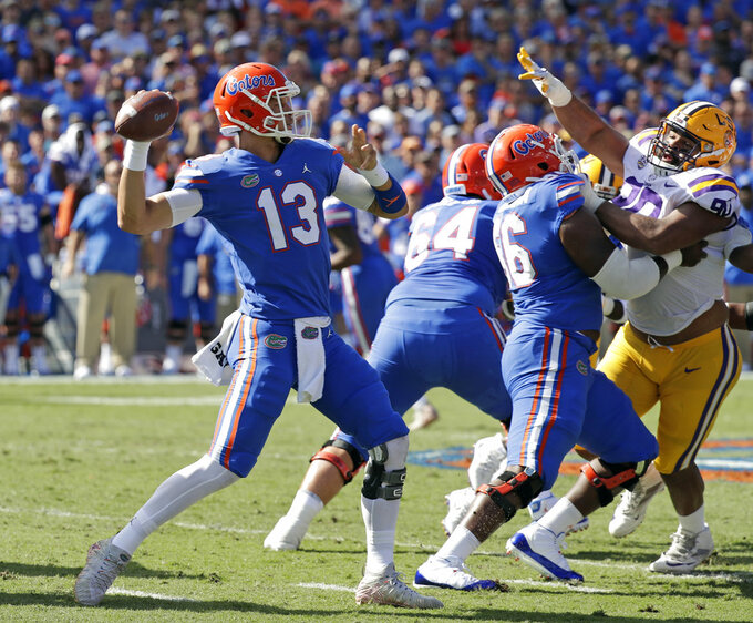 FILE - In this Oct. 6, 2018, file photo, Florida quarterback Feleipe Franks (13) throws a pass against LSU during the first half of an NCAA college football game, in Gainesville, Fla. The Georgia Bulldogs must run a gauntlet of four straight games against Southeastern Conference opponents currently ranked in the Top 25. LSU, Florida, Kentucky and Auburn. (AP Photo/John Raoux, File)