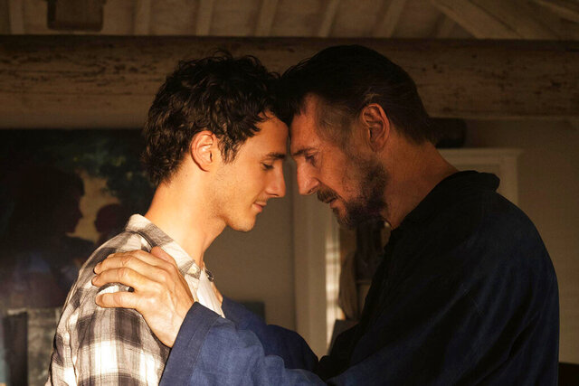 This image released by IFC Films shows Michaél Richardson, left, and his father Liam Neeson in a scene from
