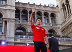 Ferrari driver Charles Leclerc salutes Ferrari fans as they attend an event to celebrate the 90th anniversary of the foundation, at Milan's Duomo square, Italy, Wednesday, Sept. 4, 2019. The F1 GP of Italy will take place at Monza race track, near Milan, Sunday. (AP Photo/Antonio Calanni)