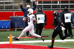 Penn State running back Devyn Ford (28) scores a touchdown past Rutgers defensive back Avery Young (2) during the first half of an NCAA college football game Saturday, Dec. 5, 2020, in Piscataway, N.J. (AP Photo/Adam Hunger)
