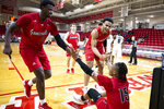 Jacksonville State guard De'Torrion Ware (33) and forward Jacara Cross (2) help teammate guard Derek St. Hilaire (15) up after a foul in the second half of an NCAA college basketball game against Chicago State at the Emerald Coast Classic in Niceville, Fla., Friday, Nov. 29, 2019. (AP Photo/Mark Wallheiser)