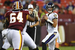 Baltimore Ravens quarterback Trace McSorley (7) looks for an opening under pressure from Washington Redskins defensive tackle JoJo Wicker (64) during the first half of an NFL preseason football game at FedEx Field in Landover, Md., Thursday, Aug. 29, 2019. (AP Photo/Susan Walsh)