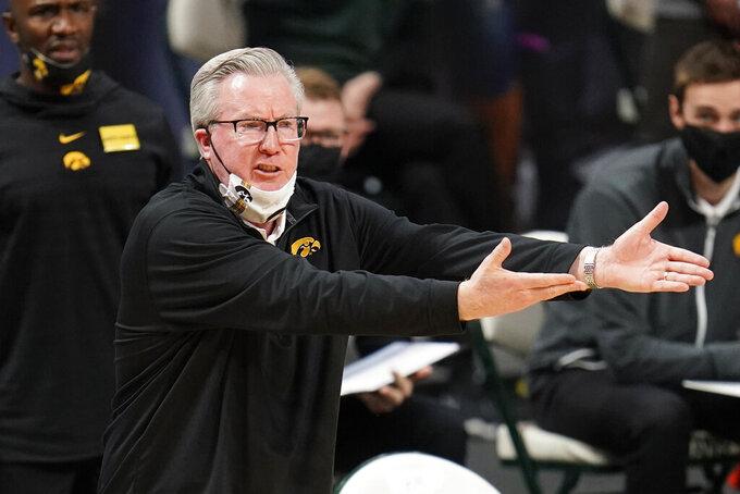Iowa head coach Fran McCaffery argues a call against Michigan State in the first half of an NCAA college basketball game in East Lansing, Mich., Saturday, Feb. 13, 2021. (AP Photo/Paul Sancya)