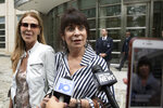 Toni Natalie, center, and Catherine Oxenberg, left, talk with the media outside Brooklyn federal court after NXIVM defendant Keith Raniere was found guilty on all counts, Wednesday, June 19, 2019 in New York. Natalie is a former member of NXIVM and Oxenberg's daughter was a member of NXIVM. (AP Photo/Mark Lennihan)