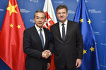 """Slovakia Foreign Affairs Minister Miroslav Lajcak, right, poses with his Chinese counterpart Wang Yi for a photo in Bratislava, Wednesday, July 10, 2019. Slovak President Zuzana Caputova has told China's foreign minister she is concern about his country's human rights problems. After meeting the minister, Wang Yi, on Wednesday, Caputova's office released a statement, saying the president """"expressed concerns and worries about the worsening state of human rights in China."""" (Pavol Zachar/TASR via AP)"""