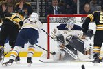 Boston Bruins' Chris Wagner (14) scores on Buffalo Sabres' Linus Ullmark (35) during the first period of an NHL hockey game in Boston, Saturday, Jan. 5, 2019. (AP Photo/Michael Dwyer)