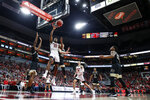 Louisville center Steven Enoch (23) dunks next to Wake Forest forward Ismael Massoud (25) during the second half of an NCAA college basketball game Wednesday, Feb. 5, 2020, in Louisville, Ky. Louisville won 86-76. (AP Photo/Wade Payne)