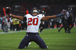 Houston Texans strong safety Justin Reid (20) celebrates his run after a turnover against the Jacksonville Jaguars during the second half of an NFL football game at Wembley Stadium, Sunday, Nov. 3, 2019, in London. The Houston Texans won 26-3. (AP Photo/Ian Walton)
