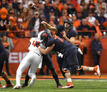 Syracuse quarterback Eric Dungey throws a pass from the pocket during the first half of an NCAA college football game against NC State in Syracuse, N.Y., Saturday, Oct. 27, 2018. (AP Photo/Adrian Kraus)