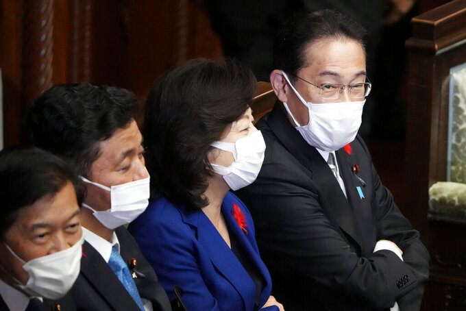 Japanese Prime Minister Fumio Kishida, right, and other lawmakers speak before dissolving the lower house, at an extraordinary Diet session at the lower house of parliament Thursday, Oct. 14, 2021, in Tokyo. Japan's new Prime Minister Kishida dissolved the lower house of parliament Thursday, paving the way for Oct. 31 national elections. (AP Photo/Eugene Hoshiko)