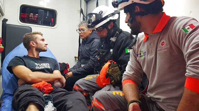In this Wednesday, Nov. 27, 2019 handout photo released by Nuevo Leon State Civil Defense Agency, survivor Aidan Jacobson sits inside an ambulance  after he was rescued after falling from the El Potrero Chico peak in Hidalgo, Mexico. Jacobson was climbing with California free solo climber Brad Gobright who died in the fall, civil defense officials in northern Mexico reported Thursday. (Nuevo Leon State Civil Defense Agency via AP)